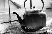 pic of boiling water  - old kettle for boiling water on charcoal stove - JPG