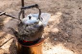 foto of boiling water  - old kettle for boiling water on charcoal stove - JPG