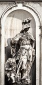 stock photo of cherub  - A cherub and  statue of a soldier in venice - JPG