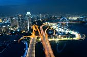 picture of singapore night  - Singapore rooftop view with highway at night and urban skyscrapers - JPG