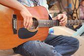 image of guitarists  - The guitarist player sitting at the park - JPG