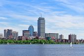 stock photo of prudential center  - Boston city skyline with Prudential Tower and urban skyscrapers over Charles River with boat - JPG