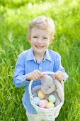 picture of easter eggs bunny  - smiling little boy holding basket with easter eggs and bunny after egg hunt at spring time - JPG