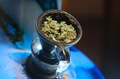 picture of bong  - Bowl of ground cannabis leaves in a water bong - JPG