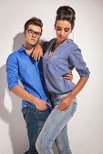 picture of she-male  - Handsome young man holding his girlfriend while she is looking down - JPG