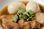 """picture of pork  - """"eggs and pork stewed in the gravy"""" or """" eggs and pork in brown sauce"""" are the traditional thai food style. - JPG"""