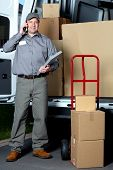 stock photo of postman  - Postman with parcel box - JPG