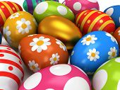 stock photo of priceless  - Unique golden egg among pale of Easter Eggs isolated on white background - JPG
