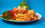 image of lobster  - Lobster thermidor baked lobster served with shrimp cocktail and French fries - JPG