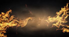 foto of skull  - Conceptual image of burning fire on dark background - JPG