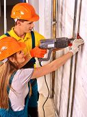 picture of millwright  - Happy woman working  and man in builder uniform indoor - JPG