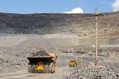 pic of mines  - Heavy mining truck on the iron ore opencast mining quarry - JPG