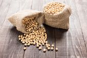 foto of soybeans  - Soybean in a bag on wooden background - JPG