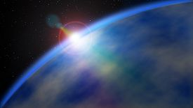 stock photo of outer  - large giant gaseous planet in deep outer space with a star flare on its outer edge - JPG
