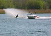 foto of ski boat  - water skier being towed behind a motor boat on a lake - JPG