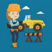 Young builder standing with arms crossed. Confident builder in hard hat. Caucasian builder standing  poster