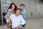 stock photo of disabled person  - Group of office workers with handicapped person - JPG