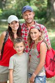 picture of family vacations  - Happy family portrait on a hiking day - JPG