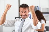 happy businessman with arms up poster