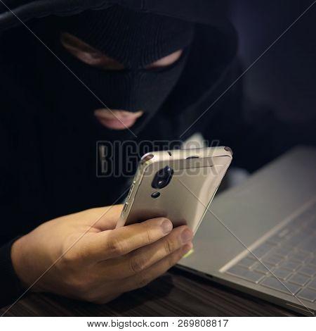 Male Hacker In A Black