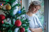 Woman Feeling Alone And Sad During Christmas Holiday poster