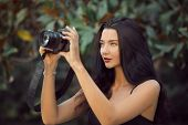 Attractive Woman Photographer Taking Images With Dslr Camera Outdoors In Park. Gorgeous Happy Mixed  poster
