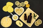 Lemon spa beauty treatment products with fresh lemons, almond oil, soap, aromatherapy essential oil, poster
