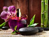 image of perfume bottles  - orchid and parfume bottle - JPG
