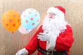 Santa Claus. Santa Claus holds Balloons. Merry Christmas Balloons. Helium Balloon. Gold Sequin Backg poster