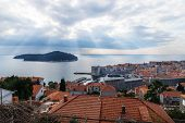 Sunrays Coming Out Of Cloudscape Over Lokrum Island With Aerial View Of Dubrovnik, Croatia poster