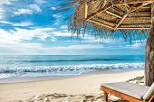 Tropical Beach With Bed And Umbrella. Beautiful View Of A White Sandy Shore And Sea In Tropics For B poster