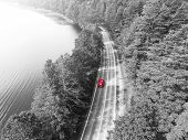Aerial View Of Highway. Aerial View Of A Country Road With Moving Red Car. Car Passing By. Aerial Ro poster