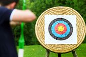 An archer with bow takes aim at target