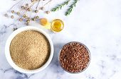 Flax Seeds, Flax Flour, Oil With Sprouts And Flax Seed Boxes On A Light Background. poster