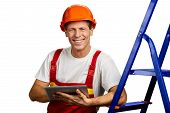 Happy Architect In Safety Helmet. Cheerful Building Inspector In Safety Helmet Holding Pc Tablet And poster