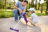 Middle Age Father And His Toddler Son Watching Break Scooter. Crash. Active Family Leisure. Child In poster