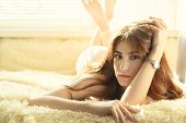 Nude Sad Pensive Girl In Sun Light Looking At Camera, Lying On Bed poster