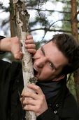 foto of fidget  - Picture of a man who gnaw their teeth wood - JPG