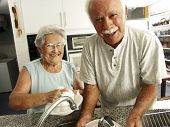 stock photo of coexist  - grandparents in a kitchen - JPG