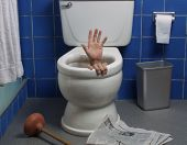 image of choke  - Hand reaches up through the seat from out of a toilet in a domestic bathroom - JPG