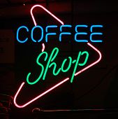 stock photo of rastaman  - coffee shop sign in amsterdam marking the location of the legal sale of marijuana - JPG