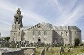 pic of windswept  - View across the windswept churchyard towards St George - JPG