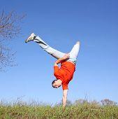 stock photo of saxy  - Break dance on grass - JPG