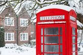 image of pinner  - Old English red phone box in winter scene - JPG