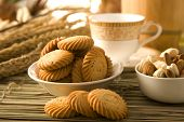 stock photo of cumin  - Jeera Biscuits with Cup Plate or Cumin Seed Cookies or Salty Cumin Seed Biscuits - JPG