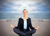 picture of single woman  - Business woman doing yoga on the beach - JPG