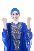 pic of muslimah  - Happy female muslim in blue dress on white background - JPG