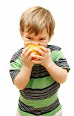 Boy Eating Orange Over White