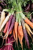 foto of farmer  - Vertical shot of multi-colored carrots at the local farmer