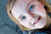 Headshot of a Little Girl Looking Straight Up at the Camera